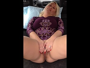 Stepmom spreads in the back of an SUV